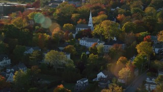 AX149_078 - 6K stock footage aerial video orbiting homes and a white church among fall foliage, autumn, Castine, Maine