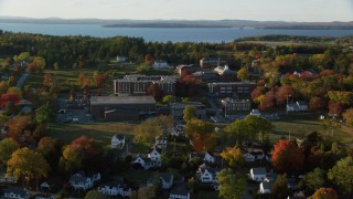 AX149_080 - 6K stock footage aerial video approaching the Maine Maritime Academy, autumn, Castine, Maine