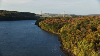 AX149_094 - 6K stock footage aerial video flying along fall foliage toward Penobscot Narrows Bridge, autumn, Stockton Springs, Maine