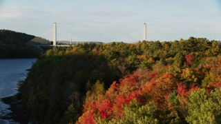 AX149_096 - 6K stock footage aerial video revealing the Penobscot Narrows Bridge, autumn, Stockton Springs, Maine