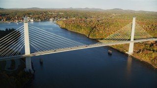 AX149_100 - 6K stock footage aerial video flying by the Penobscot Narrows Bridge, autumn, Stockton Springs,  Maine