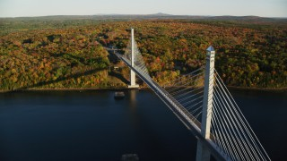 AX149_101 - 6K stock footage aerial video orbiting away from the Penobscot Narrows Bridge, autumn, Stockton Springs, Maine