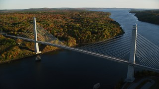 AX149_102 - 6K stock footage aerial video flying away from the Penobscot Narrows Bridge, autumn, Stockton Springs, Maine