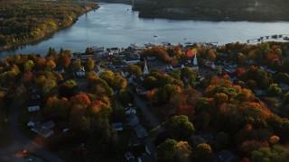 AX149_106 - 6K stock footage aerial video orbiting a small coastal town on the Penobscot River, autumn, Bucksport, Maine