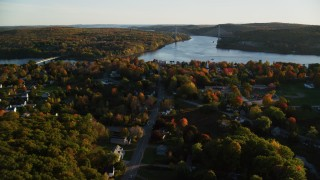 AX149_111 - 6K stock footage aerial video approaching Penobscot Narrows Bridge from over small town, autumn, Bucksport, Maine