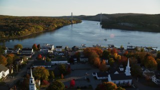 AX149_113 - 6K stock footage aerial video flying over small town, approach Penobscot Narrows Bridge, autumn, Bucksport, Maine