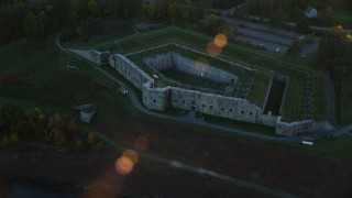 AX149_114 - 6K stock footage aerial video approaching Fort Knox and tilt down, autumn, Stockton Springs, Maine, sunset