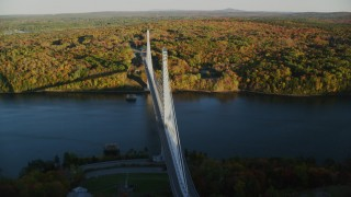 AX149_115 - 6K stock footage aerial video flying by Penobscot Narrows Bridge, Penobscot River, autumn, Maine