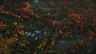 AX149_188 - 6K stock footage aerial video flying by rural homes, Woodmans Mill Road, autumn, Liberty, Maine, sunset