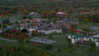 AX149_228 - 6K stock footage aerial video flying by Maine government offices, autumn, Augusta, Maine, twilight