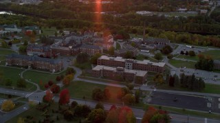 AX149_232 - 6K stock footage aerial video orbiting green lawns, Maine government buildings in autumn, Augusta, Maine, twilight