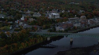 AX149_234 - 6K stock footage aerial video flying by small bridge, downtown, Superior Court, autumn, Augusta, Maine, twilight