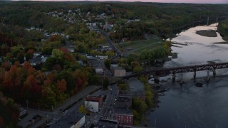 AX149_236 - 6K stock footage aerial video flying over Northern Avenue, approach Saint Augustine Catholic Church, autumn, Augusta, Maine, twilight