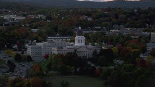 AX149_251 - 6K stock footage aerial video flying by Maine State House, colorful foliage in autumn, Augusta, Maine, twilight