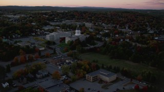 AX149_252 - 6K stock footage aerial video approaching the Maine State House, autumn, Augusta, Maine, twilight