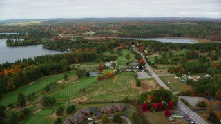 AX150_005 - 6K stock footage aerial video flying over the Augusta Golf Course, Western Avenue, autumn, Manchester, Maine
