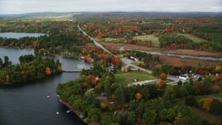 AX150_006 - 6K stock footage aerial video flying by waterfront homes, Western Avenue, autumn, Winthrop, Maine