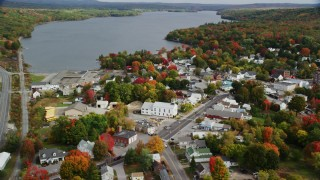 AX150_016 - 6K stock footage aerial video orbiting Winthrop United Methodist Church, small town, autumn, Winthrop, Maine