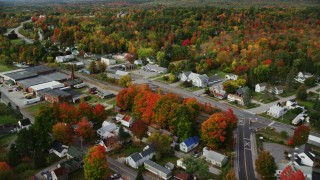 AX150_022 - 6K stock footage aerial video flying over small town, homes, factory, roads, autumn, Winthrop, Maine