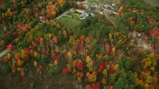 AX150_030 - 6K stock footage aerial video of a bird's eye view over colorful trees, reveal river, Bog Road, autumn, Leeds, Maine