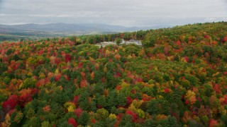 AX150_055 - 6K stock footage aerial video flying by colorful forest, isolated home, Turner, Maine