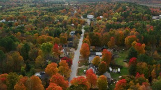 AX150_068 - 6K stock footage aerial video flying over small town, rural homes, Buckfield Road, autumn, Buckfield, Maine
