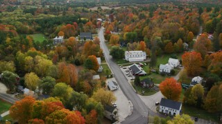 AX150_069 - 6K stock footage aerial video flying over small town, rural homes, Turner Street, autumn, Buckfield, Maine