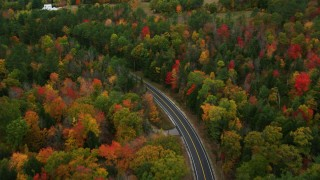 AX150_080 - 6K stock footage aerial video tilting up from Buckfield Road to colorful trees in autumn, Paris, Maine