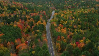 AX150_081 - 6K stock footage aerial video flying over Buckfield Road, forest of brightly colored trees, autumn, Paris, Maine