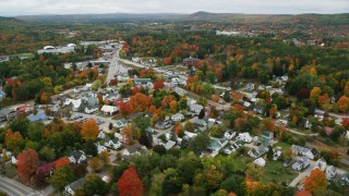 AX150_084 - 6K stock footage aerial video orbiting small rural town, brightly colored foliage, autumn, Paris, Maine