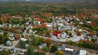 AX150_086 - 6K stock footage aerial video orbiting small rural town with colorful trees, autumn, Paris, Maine
