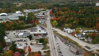 AX150_092 - 6K stock footage aerial video flying over Main Street, small rural town, autumn, Paris, Maine