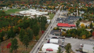 AX150_094 - 6K stock footage aerial video flying over Main Street, approach Oxford Hills Comprehensive High School, Paris, Maine