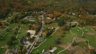 AX150_181 - 6K stock footage aerial video flying over small rural town, Wentworth Golf Club, approach cemetery, autumn, Jackson, New Hampshire