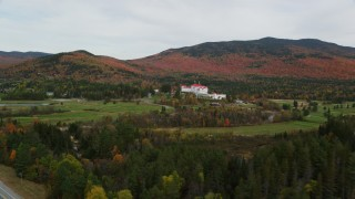 AX150_205 - 6K stock footage aerial video of Omni Mount Washington Resort, Bretton Woods, overcast, autumn, Carroll, New Hampshire