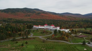 AX150_206 - 6K stock footage aerial video orbiting Omni Mount Washington Resort, Bretton Woods, autumn, Carroll, New Hampshire