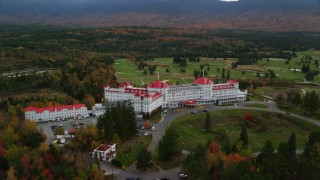 AX150_207 - 6K stock footage aerial video of Omni Mount Washington Resort, Bretton Woods, Mount Washington Resort Golf Club, Carroll, New Hampshire