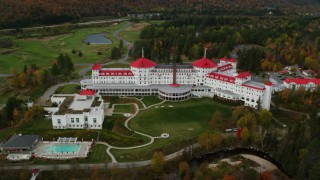 AX150_209 - 6K stock footage aerial video orbiting Omni Mount Washington Resort, golf club, autumn, Carroll, New Hampshire