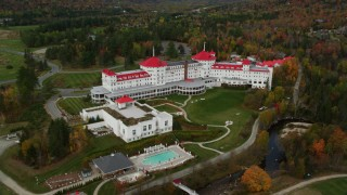 AX150_210 - 6K stock footage aerial video orbiting Omni Mount Washington Resort, autumn, Bretton Woods, Carroll, New Hampshire