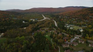 AX150_211 - 6K stock footage aerial video approaching Base Station Road, Highway 302, over rural homes, Carroll, New Hampshire