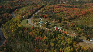 AX150_230 - 6K stock footage aerial video flying by Highway 302, Mountain Roots Farm, autumn, Bethlehem, New Hampshire