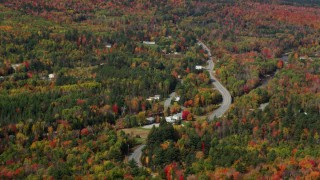 AX150_231 - 6K stock footage aerial video fFlying by rural homes, Main Street, autumn, Bethlehem, New Hampshire