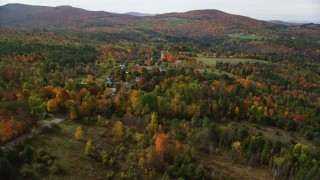 AX150_246 - 6K stock footage aerial video approaching small rural town, colorful foliage, autumn, Sugar Hill, New Hampshire