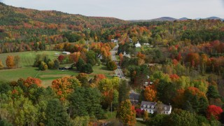 AX150_251 - 6K stock footage aerial video flying over small rural town, approach Sugar Hill Road, autumn, Sugar Hill, New Hampshire