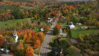 AX150_252 - 6K stock footage aerial video flying over Sugar Hill Road through small rural town, autumn, Sugar Hill, New Hampshire