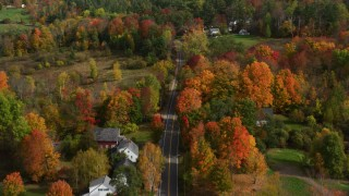 AX150_253 - 6K stock footage aerial video flying over Sugar Hill Road through aura town, bright trees, autumn, Sugar Hill, New Hampshire