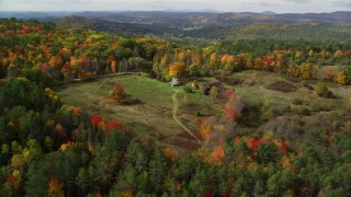 AX150_264 - 6K stock footage aerial video approaching an isolated rural home, tilt down, autumn, Lisbon, New Hampshire