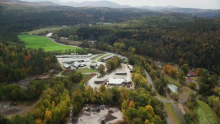 AX150_269 - 6K stock footage aerial video approaching, flying by saw mill and tilt down, autumn, Bath, New Hampshire