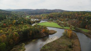 AX150_271 - 6K stock footage aerial video flying over Ammonoosuc River, approach small town, autumn, Bath, New Hampshire