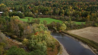 AX150_278 - 6K stock footage aerial video flying by rural town, over Ammonoosuc River, autumn, Bath, New Hampshire